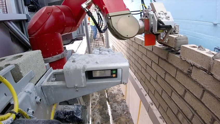 A collaborative robot in construction work being utilised by various companies.