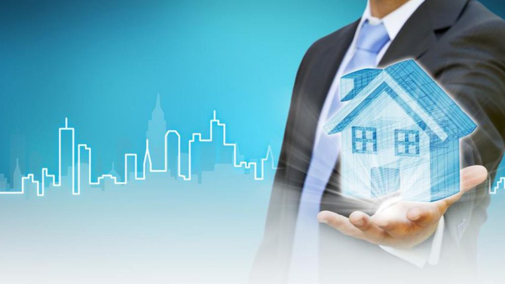 Image showing a real estate agent holding the digitalised property,.